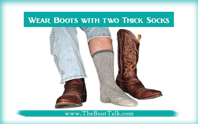 wear cowboy boots with two thick socks to break in